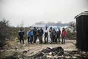 March 1, 2016 - Calais, France -<br /> <br /> Destruction Of Calais Jungle Camp Continues<br /> <br /> Migrants in the 'jungle' migrant camp on March 01, 2016 in Calais, France. Authorities return to clear migrant shelters from more parts of the 'Jungle' migrant camp in Calais and try to move people to shipping containers on another part of the site. French demolition teams began dismantling huts yesterday. Resistance is expected to continue and overnight riot police fired teargas at migrants who were throwing stones. A court ruling on Thursday approved a French Govt plan to clear part of the site. Authorities say approx 1,000 migrants are to be affected out of 3,700 people - many of them refugees from Syria and Iraq - who are thought to live in the camp. Mayor of Calais Natacha Bouchart has demanded the closure of the site for several weeks following several recent clashes with police  <br /> ©Exclusivepix Media