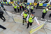 Mounting Police rush into the entry of the Westminster Palace as Extinction Rebellion activists glued themselves in Parliament Square, outside Westminster Palace of the Houses of Parliament on Thursday, Sept 3, 2020. Environmental non-violent activists group Extinction Rebellion enters its 3rd day of continuous ten days to disrupt political institutions throughout peaceful actions swarming central London into a standoff, demanding that central government obeys and delivers Climate Emergency bill.