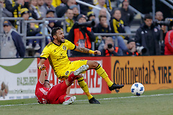November 4, 2018 - Columbus, OH, U.S. - COLUMBUS, OH - NOVEMBER 04: New York Red Bulls midfielder Sean Davis (27) slide tackles Columbus Crew midfielder Artur (8) in the MLS eastern conference semifinals game between the Columbus Crew SC and the New York Red Bulls on November 04, 2018 at Mapfre Stadium in Columbus, OH. The Crew won 1-0. (Photo by Adam Lacy/Icon Sportswire) (Credit Image: © Adam Lacy/Icon SMI via ZUMA Press)