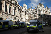 Police vans parked outside the Old War Office Building in London, England, United Kingdom. Former office building with 1,100 rooms used by Churchill as a headquarters during World War II.