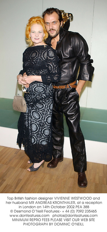 Top British fashion designer VIVIENNE WESTWOOD and her husband MR ANDREAS KRONTHALER, at a reception in London on 14th October 2002.PEA 388