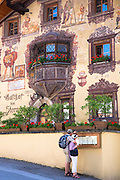 Tourists look at menu at Gasthof Stern hotel in Kirchweg in the old part of the town of Oetz in the Tyrol, Austria