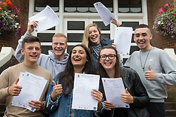 """© Licensed to London News Pictures. 15/08/2016. Sutton Coldfield, West Midlands,UK. Bishops Vesey's Grammar School pupils celebrating their A level results. Pictured from left, Ben Brady, Daniel Carruthers, Sofia Kaur, Jemina Richardson-Jones, Lucy Parize, Rory Gaskin, all 18. Headmaster Dominic Robson said, """"The pupils had done amazingly well, achieving 80% A star and B grades especially given the change to the marking of the A level system this year. Photo credit: Dave Warren/LNP"""