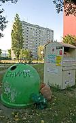 Recycling bins framing the despised Communist built Blok houses. Balucki District Lodz Central Poland