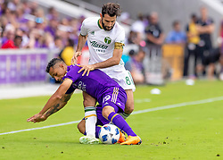 April 8, 2018 - Orlando, FL, U.S. - ORLANDO, FL - APRIL 08: Orlando City defender Yoshimar Yotun (19) is pressured by Portland Timbers midfielder Diego Valeri (8) during the MLS soccer match between the Orlando City FC and the Portland Timbers at Orlando City SC on April 8, 2018 at Orlando City Stadium in Orlando, FL. (Photo by Andrew Bershaw/Icon Sportswire) (Credit Image: © Andrew Bershaw/Icon SMI via ZUMA Press)