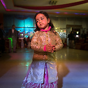 A young girl dancing at the end of the wedding Banquet.