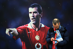 10 December 2017 -  Premier League - Manchester United v Manchester City - An image of Roy Keane overlooks a fan checking his mobile phone - Photo: Marc Atkins/Offside