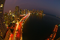Downtown Panama City at twilight with Panama Bay in foreground, Panama