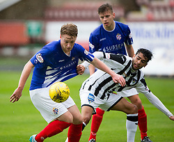 Cowdenbeath's Christopher Kane  and Dunfermline's Faissal El Bahktaoui. Half time : Dunfermline 0 v 0 Cowdenbeath, Scottish League Cup game played today at East End Park.