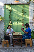 A couple working at the JugMugThela shop in Champa Gali, New Delhi, India. Champa Gali is the latest and most intimate of Delhis urban creative villages. A tiny hidden lane is home to pop-ups and creatives.