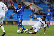 Nathaniel Mendez-Laing of Cardiff city is tackled by Tom Huddlestone of Derby county ®.EFL Skybet championship match, Cardiff city v Derby County at the Cardiff city stadium in Cardiff, South Wales on Saturday 30th September 2017.<br /> pic by Andrew Orchard, Andrew Orchard sports photography.