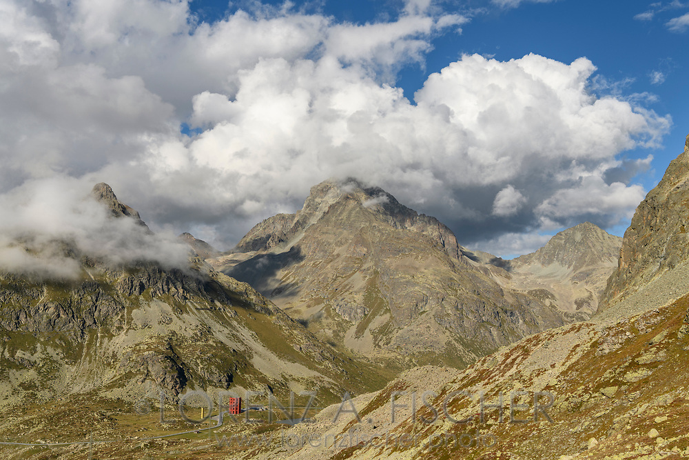 Clouds over the peaks of Botta dal Tiroler, Piz Julier and Piz Albana and the mountain pass Julier, Parc Ela, Grisons, Switzerland