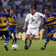 Manchester United's Ole Gunnar Solskjaer and Parma's Paolo Cannavaro battle for the ball