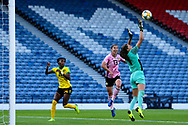 Sydney Schneider (#1) of Jamaica gets a hand to the ball to stop Jane Ross (#13) of Scotland from having a chance on goal during the International Friendly match between Scotland Women and Jamaica Women at Hampden Park, Glasgow, United Kingdom on 28 May 2019.