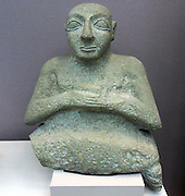 Stone statue of Kurlil From Tell al-'Ubaid, southern Iraq, Early Dynastic period, about 2500 BC. Found next to the Temple of Ninhursag.  limestone statue was excavated in 1919 besides the ruins of the temple at Tell al-'Ubaid dedicated to the Sumerian fertility goddess Ninhursag. A very damaged sculpture was found alongside it, with only the upper part of the body surviving. A cuneiform inscription identifies it as Kurlil, an official in the city of Uruk who had dedicated the image to the goddess Damkina at Tell al-'Ubaid. A cuneiform sign on the right shoulder of this statue, though very worn, can be identified as part of Kurlil's name.