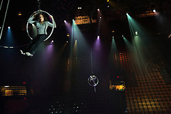 """Aerialists practice with while the show is set up in Fairfax. <br /> Ringling Bros. and Barnum & Bailey Circus started in 1919 when the circus created by James Anthony Bailey and P. T. Barnum merged with the Ringling Brothers Circus. Currently, the circus maintains two circus train-based shows, the Blue Tour and the Red Tour, as well as the truck-based Gold Tour. Each train is a mile long with roughly 60 cars: 40 passenger cars and 20 freight. Each train presents a different """"edition"""" of the show, using a numbering scheme that dates back to circus origins in 1871 — the first year of P.T. Barnum's show."""