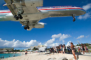 Maho Beach. Plane watchers welcome an American Airlines Boeing 767 landing at Juliana Airport.