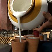 Fresh lassi poured into kulhars on M.I road, Jaipur. April 2007