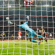Galatasaray's Umut Bulut (R) scores and Kayserispor's goalkeeper Mahmut Erutgrul Taskiran (L) during their Turkish Super League soccer match Galatasaray between Kayserispor at the TT Arena at Seyrantepe in Istanbul Turkey on Saturday, 27 October 2012. Photo by TURKPIX