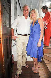 """JOHN RENDALL and his daughter TALLULAH RENDALL at a party to celebrate the publication of the Paper back edition of """"A Lion Called Christian"""" held at Julie's Restaurant & Bar, 135 Portland Road, London W11 on 28th June 2010."""