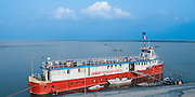 Bangladesh, Jamuna River, (called the Brahmaputra River in India) near the town of Gaibanda. The boat based Friendship non-profit organization (NGO), who provide health care and vocational traing  for locals. The hospital ship is docked beside a beach.