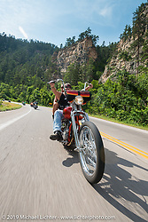 Les Covington and Michelle from Portland on the Legends Ride from Deadwood, SD through Spearfish Canyon and to the Sturgis Buffalo Chip during the Sturgis Black Hills Motorcycle Rally. SD, USA. August 4, 2014.  Photography ©2014 Michael Lichter.