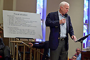 Aug, 25, 2009 -- SUN CITY, AZ: SEN JOHN MCCAIN reads a statement during the Town Hall meeting on health care sponsored by Sen McCain at Grace Bible Church in Sun City, AZ, Tuesday. More than 1,000 people attended the meeting in the church, which seats 700. Sun City is a staunchly Republican suburb of Phoenix and most of the crowd was opposed to President Obama health care reform efforts.     Photo by Jack Kurtz