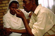Sister Beatha Mukakaba comforts Venant after his HIV results, Kibileze Health Centre, Kibileze, Rwanda.