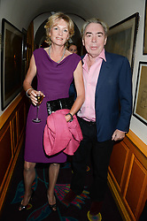 LORD & LADY LLOYD WEBBER at an exhibition of the 50 best party pictures from Tatler from the past 50 years, held at Annabel's, Berkeley Square, London on 9th September 2013.