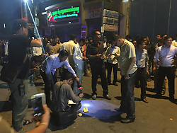 PHNOM PENH, Sept. 7, 2016 (Xinhua) -- Cambodian policemen inspect the scene where a bomb exploded in Phnom Penh, Cambodia, Sept. 6, 2016. A bomb exploded on a roadside in Phnom Penh, capital of Cambodia, on Tuesday night, injured three persons, according to police. (Xinhua/Phearum)(axy) (Credit Image: © Phearum/Xinhua via ZUMA Wire)
