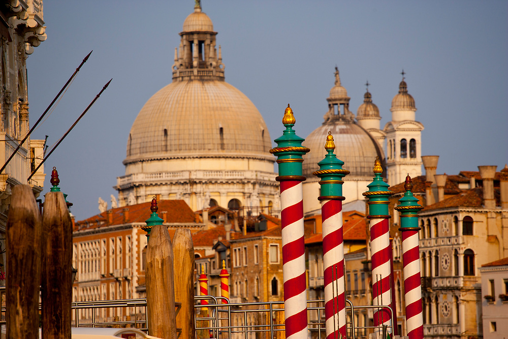 View of the domes on the church of Santa Maria della Salute or St. Mary of Health from a canal in Venice Italy