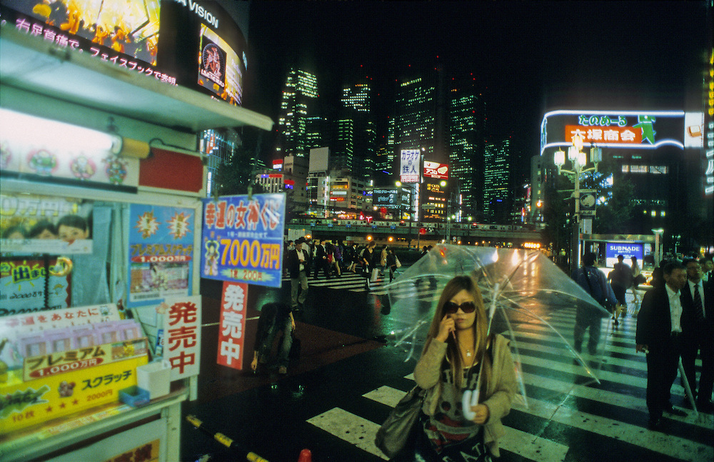 Woman in the rain in Shinjuku, Tokyo, Japan.