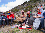 A Quechua priest prepares an offering to the spirits of the Andes Mountains, at Lago Humantay, near Soraypampa, Peru.