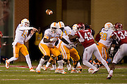 Nov 12, 2011; Fayetteville, AR, USA;  Tennessee Volunteers quarterback Justin Worley (14) makes a thrown during a game against the Arkansas Razorbacks at Donald W. Reynolds Razorback Stadium. Arkansas defeated Tennessee 49-7. Mandatory Credit: Beth Hall-US PRESSWIRE