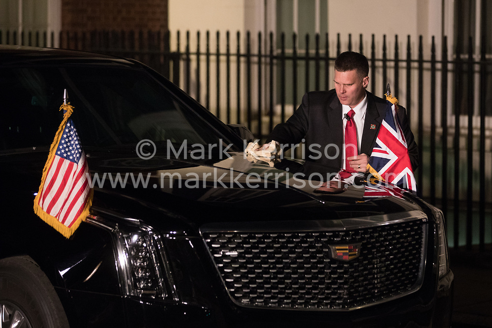 London, UK. 3 December, 2019. A man polishes the Beast outside 11 Downing Street before the departure of President Trump and his wife Melania following a reception for NATO leaders on the eve of the military alliance's 70th anniversary summit at a luxury hotel near Watford.