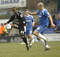 Photo: Aidan Ellis.<br /> Oldham Athletic v Swansea City. Coca Cola League 1. 22/04/2006.<br /> Swansea's Leon Knight beats Oldham's Guy Branston to the ball