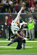 Miami Dolphins wide receiver Danny Amendola (80) gets upended by Houston Texans linebacker Josh Keyes (49) as he catches a second quarter pass for a gain of 13 yards and a first down at the Dolphins 45 yard line during the NFL week 8 regular season football game against the Houston Texans on Thursday, Oct. 25, 2018 in Houston. The Texans won the game 42-23. (©Paul Anthony Spinelli)