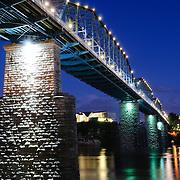 Night shot of the Walnut Street Bridge at night. It's an old rail bridge converted to a pedestrian bridge.