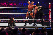 Roman Reigns fights Triple H for the WWE World Heavyweight Championship during WrestleMania on April 3, 2016 in Arlington, Texas.