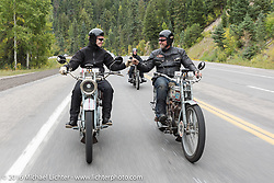 Thomas Trapp (R), owner of the Harley-Factory Frankfurt dealership in Germany rides his 1916 Harley-Davidson down the west side of Wolf Creed Pass with son Eric (L) and Paul Jung (in back, also from Germany) during the Motorcycle Cannonball Race of the Century. Stage-10 ride from Pueblo, CO to Durango, CO. USA. Tuesday September 20, 2016. Photography ©2016 Michael Lichter.