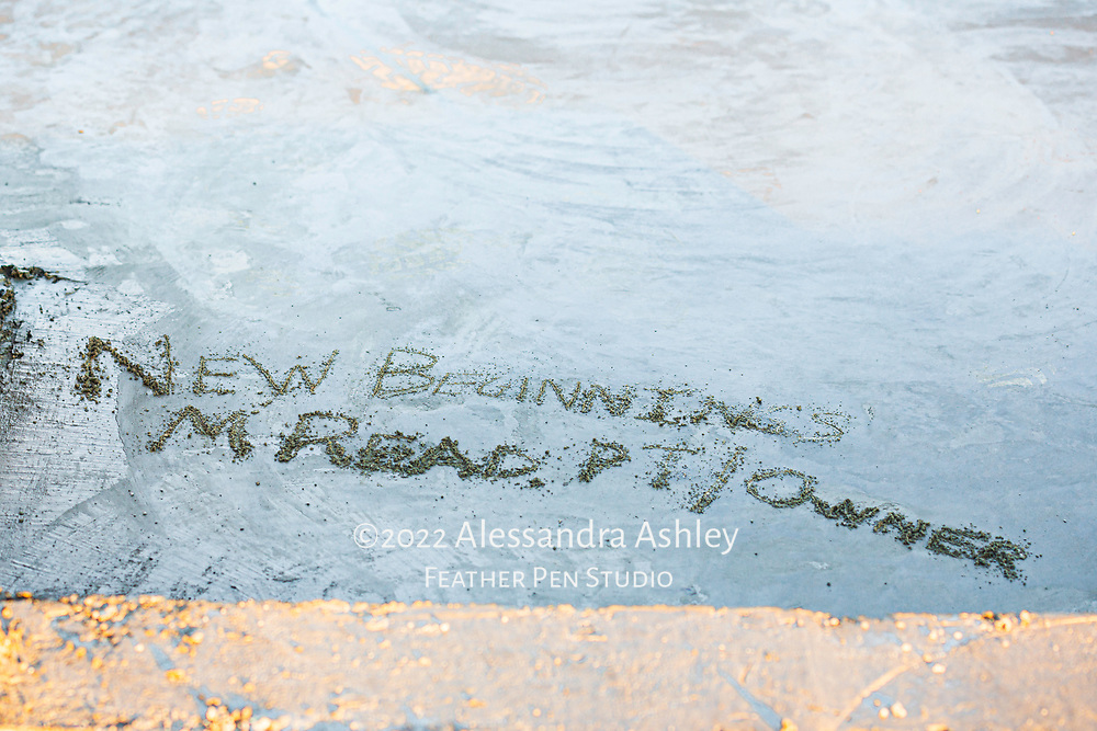 """""""New Beginnings"""" message written in wet cement by owner at future site of new physical therapy and wellness center building in Lewis Center, Ohio."""