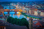 The river Arno and Ponte Vecchio bridge in Firenze (Florence), Italy.<br /> -----<br /> Captured with a Canon 5D Mk III camera and Canon EF 70-200/4L IS lens  <br /> -----<br /> Florence (Italian: Firenze) is the capital city of the Italian region of Tuscany and of the province of Florence. It is the most populous city in Tuscany, with approximately 370,000 inhabitants, expanding to over 1.5 million in the metropolitan area.<br /> Florence is famous for its history. A centre of medieval European trade and finance and one of the wealthiest cities of the time, Florence is considered the birthplace of the Renaissance, and has been called the Athens of the Middle Ages. A turbulent political history includes periods of rule by the powerful Medici family, and numerous religious and republican revolutions. From 1865 to 1871 the city was also the capital of the recently established Kingdom of Italy.<br /> The historic centre of Florence attracts millions of tourists each year, and Euromonitor International ranked the city as the world's 72nd most visited in 2009, with 1,685,000 visitors. It was declared a World Heritage Site by UNESCO in 1982. Due to Florence's artistic and architectural heritage, it has been ranked by Forbes as one of the most beautiful cities in the world, and the city is noted for its history, culture, Renaissance art and architecture and monuments. The city also contains numerous museums and art galleries, such as the Uffizi Gallery and the Pitti Palace, amongst others, and still exerts an influence in the fields of art, culture and politics.<br /> Florence is also an important city in Italian fashion, being ranked within the top fifty fashion capitals of the world; furthermore, it is also a major national economic centre, being a tourist and industrial hub. In 2008, the city had the 17th highest average income in Italy.