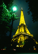 Impressionistic view Eiffel Tower at Night with street lamp.