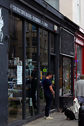 Trade in trendy Stockbridge in Edinburgh's New Town is slowly picking up with cafes, bars and shops finding their feet in Phase III of the move from lockdown in Scotland. Charity shops are always popular with some shops taking the opportunity to refresh their look for the retirning customers.