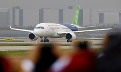 May 5, 2017 - Shanghai, China - China's homegrown large passenger plane C919 taxies on a runway ahead of its maiden flight. The twin-engine C919 today completed its maiden flight from Shanghai Pudong International Airport. China is attempting to replace all 6,000-6,800 of its western aircraft at a cost of around $1 trillion. COMAC spent 11 years and $6.5 billion developing the plane as a part of China's aviation dreams. (Credit Image: © Fang Zhe/Xinhua via ZUMA Wire)