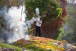 April 2, 2017 - Ban Hin Kong, Saraburi, Thailand - A Thai-Chinese spread flowers to the deceased in a cemetery in Saraburi province, Thailand.The Qingming Festival this year, is a traditional Chinese holiday for mourning the dead. (Credit Image: © Panupong Changchai/Pacific Press via ZUMA Wire)