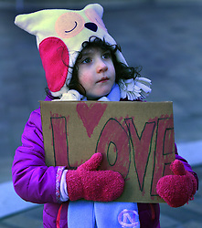 """December 10, 2016 - Washington, DC, USA - CLARA KENT LAVY, 4 years old, from DC holds a sign saying ''Love''.  Children's Rally for Kindness takes place at Trump International Hotel in Washington DC on December 10, 2016 organized by the Takoma Parents Action Coalition.  According to their FaceBook page, it was a call to President-elect Donald Trump: ''to remember these lessons as he prepares to take office and implement policies that will affect the lives of children and families across our diverse nation.''.''All over the world, across cultures and countries, children learn the same basic lessons: .Ã'be kind,Ã"""" .Ã'tell the truth,Ã"""" .Ã'be fair,Ã"""" .Ã'respect everyone,Ã"""" .Ã'treat others the way you want to be treated,Ã"""" .Ã'donÃ•t touch others if they donÃ•t want to be touched. (Credit Image: © Carol Guzy via ZUMA Wire)"""