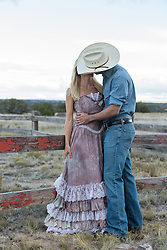 cowboy kissing a beautiful girl outdoors