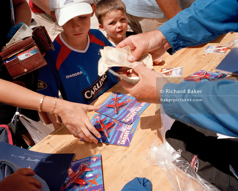 Young fans of the 'Red Arrows', Britain's Royal Air Force aerobatic team, collect memorablia.