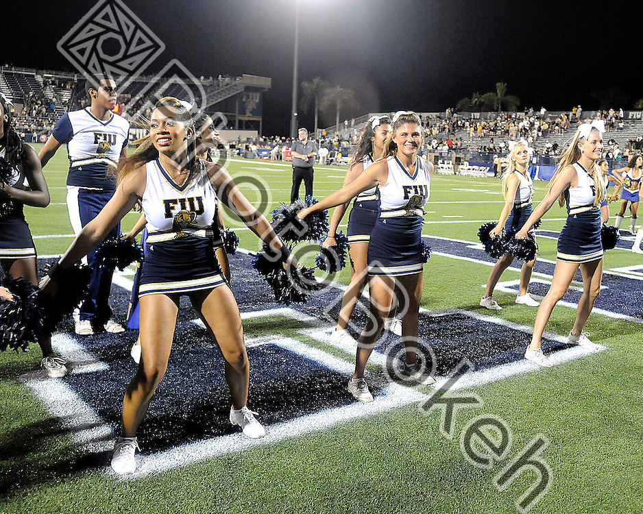 2011 September 17 - The FIU Cheerleaders cheering on the sidelines. Florida International University Golden Panthers defeated the Golden Knights of the University of Central Florida, 17-10, at the FIU Football Stadium, Miami, Florida. (Photo by: www.photobokeh.com / Alex J. Hernandez)